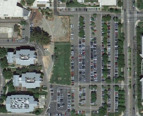 See Y St. just to the left of center on this Google Maps satellite view? The dirt where that vehicle is parked just to the right of Y Street in the UC Davis medical complex was part of the old Sacramento Mile, the main straight just about at the start-finish line. Since this image was taking the forgotten little spot of sacred racing dirt has been converted into a green space with grass, picnic tables and benches. (Google Maps)