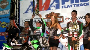 Bryan Smith (in cap), of Flint, Mich.,holds up the winner's trophy after taking victory in the 50th running of the Sacramento Mile AMA Pro Grand National motorcycle race at Cal Expo on Saturday night. Smith shares the podium with third-place finisher Jared Mees (left) and runner up Brandon Robinson. (Photo by Larry Lawrence/SactoMile.com)
